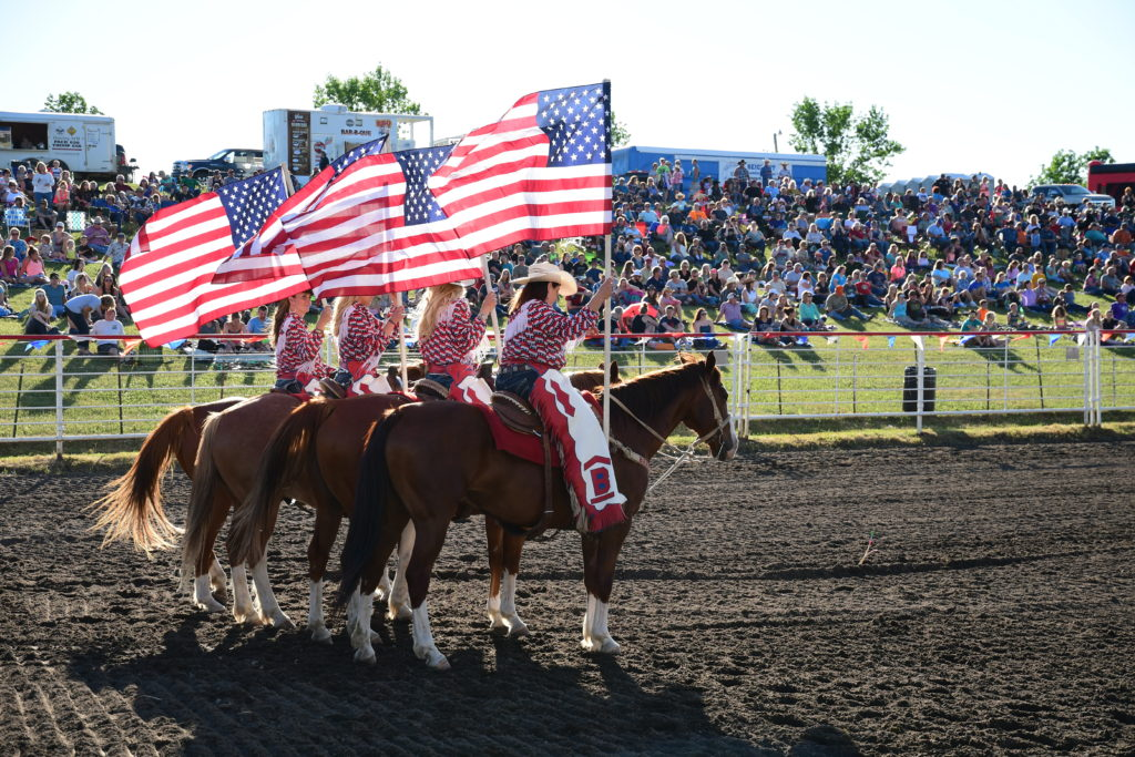 Flag Girls during grand entry include Rodeo Co-Chair Amy Anderson_photo credit Gretchen Kirchmann